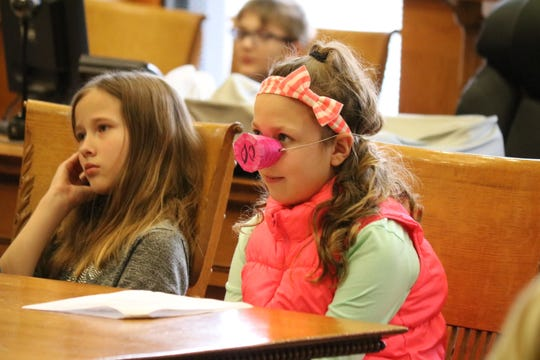 """""""Curly Pig,"""" played by Casey Brand, a fifth-grade student at Bataan Memorial, was being sued by the """"Big Bad Wolf"""" in a mock trial that helped them learn about the justice system Tuesday."""