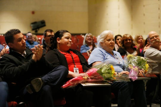 Facutly and staff applaud school nurses, from left, Dawn Dragonetti and Mary Merenda during a staff meeting at Van Wyck Junior High School in Wappingers Falls on March 4, 2019. The pair were recognized for successfully resuscitating a parent who fainted and went into cardiac arrest.