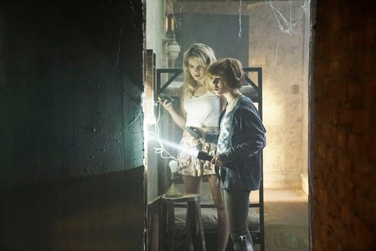 """In """"Nancy Drew and the Hidden Staircase,"""" Nancy (Sophia Lillis), right, and Helen (Laura Slade Wiggins) must investigate the strange goings-on within Helen's aunt's haunted house."""