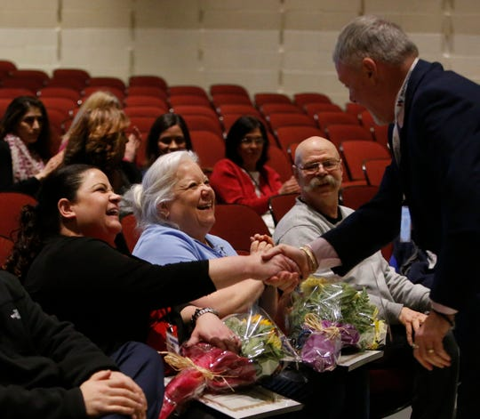 Wappingers Central School District assistant superintendent Dwight Bork thanks school nurses, from left, Dawn Dragonetti and Mary Merenda during a staff meeting at Van Wyck Junior High School in Wappingers Falls on March 4, 2019. The pair were recognized for successfully resuscitating a parent who fainted and went into cardiac arrest.