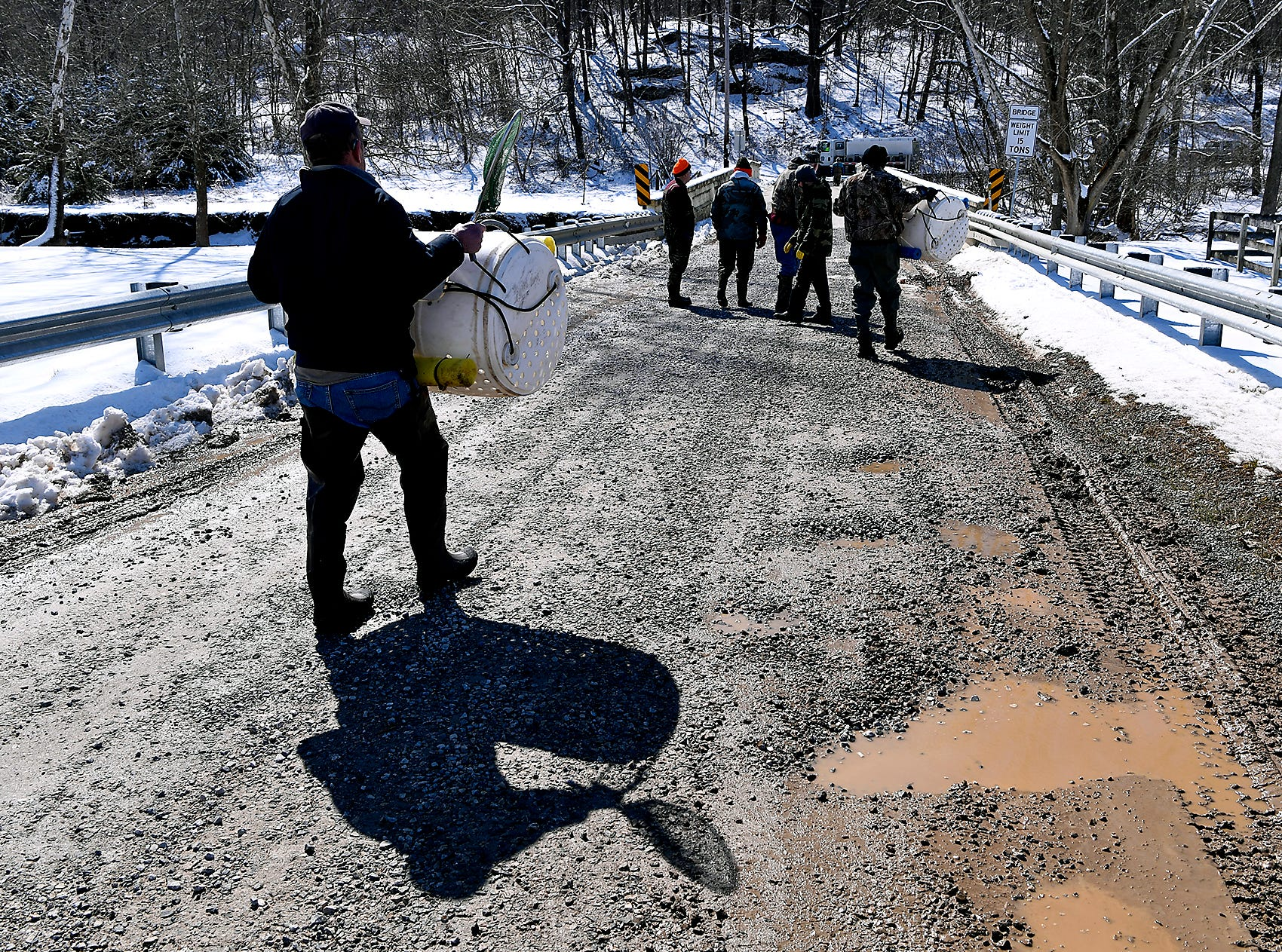 Volunteers from local sportsman's groups help Fish Commission stocking trout in Muddy Creek and Bald Eagle Creek in southeastern York County, Tuesday, March 5, 2019. The stocking was the first of several that will happen before trout season opens on March 30.John A. Pavoncello photo