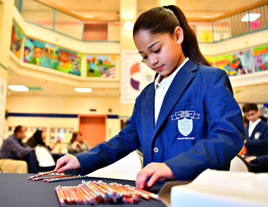 Fifth-grade student ambassador Eliangeliz Echevarria, 11, counts out pencils to be delivered to classrooms in celebration of National School Breakfast Week at Lincoln Charter School in York City, Tuesday, March 5, 2019. Dawn J. Sagert photo