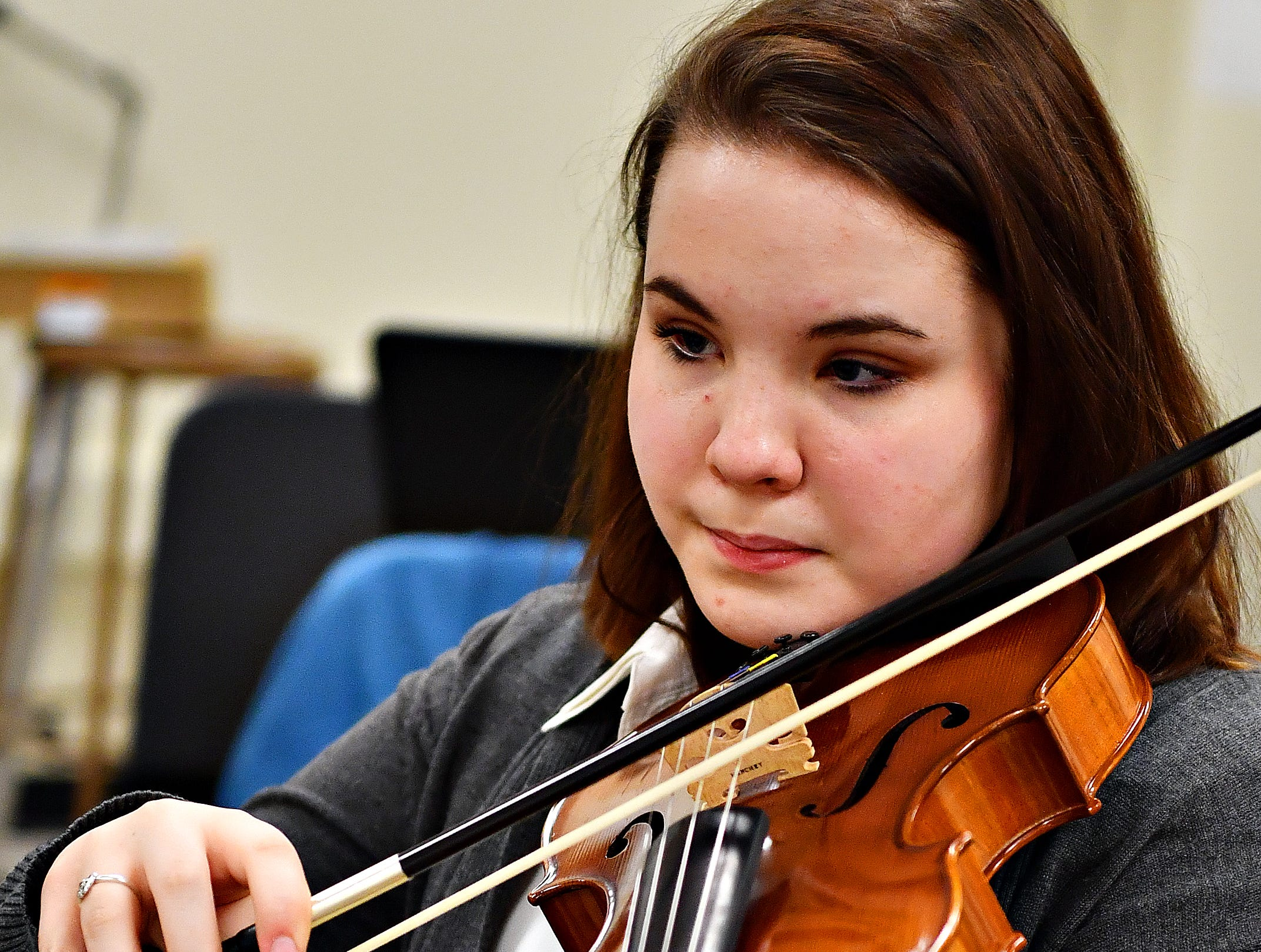 Lina Banzaca plays viola while her ensemble works with Red Lion alumnus Derek Cooper, a working composer in New York, gestures while working with a student ensemble at Red Lion Area High School in Red Lion, Tuesday, March 5, 2019. Dawn J. Sagert photo