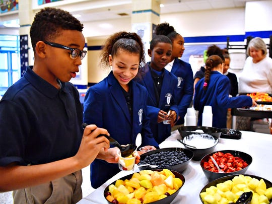 Caden Tarver, left, builds his fruit parfait while fellow fourth-grader Alessa Williams looks on as students and student ambassadors join community members for breakfast in celebration of National School Breakfast Week at Lincoln Charter School in York City, Tuesday, March 5, 2019. Dawn J. Sagert photo