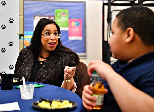 Mildred Tavarez, left, who sits on the West York Borough Council, talks to fourth-grader Johnny Dickerson, 10, as students and community members enjoy breakfast together in celebration of National School Breakfast Week at Lincoln Charter School in York City, Tuesday, March 5, 2019. Dawn J. Sagert photo