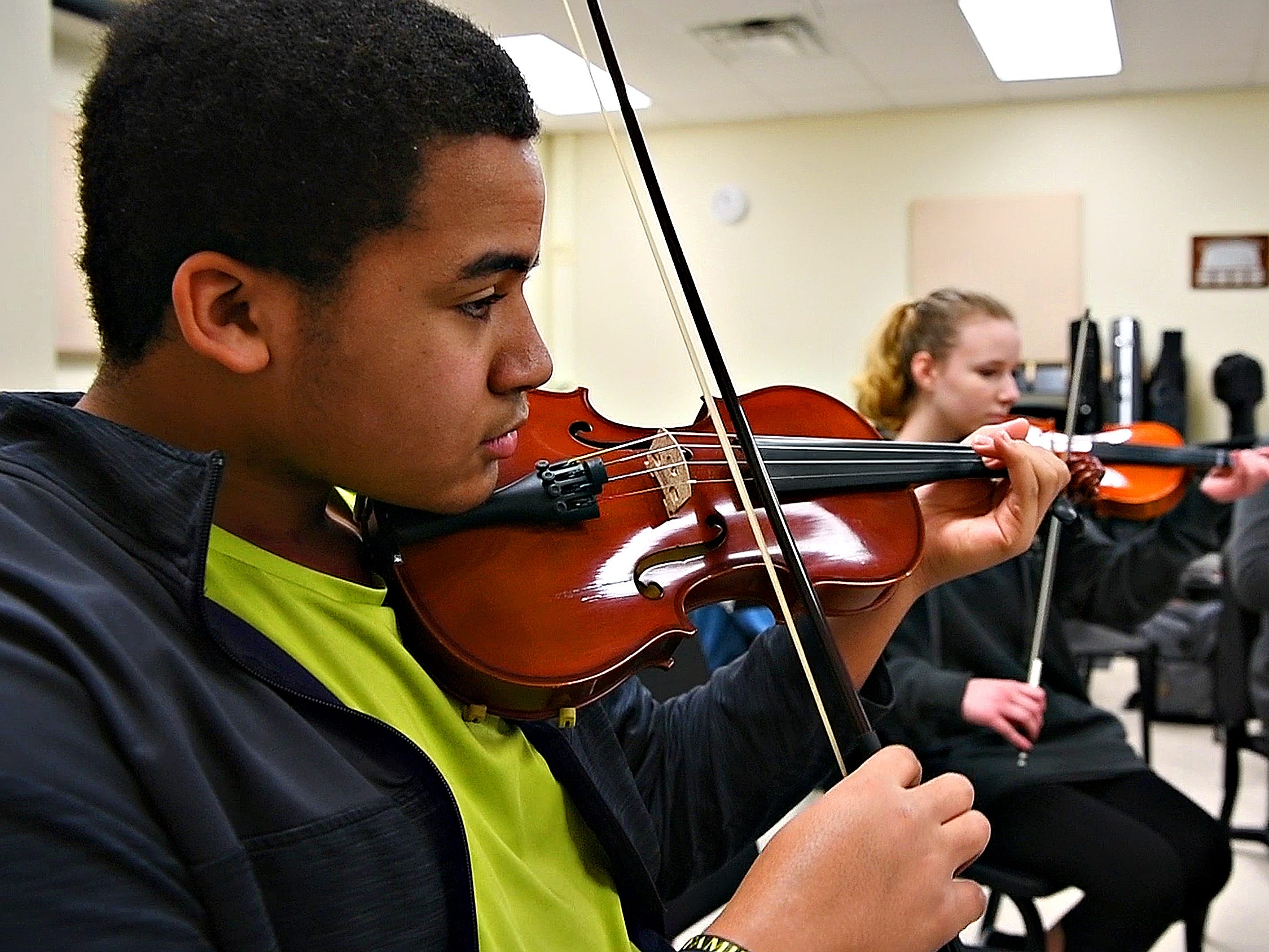 Chandler Adams plays violin while his ensemble works with Red Lion alumnus Derek Cooper, a working composer in New York, gestures while working with a student ensemble at Red Lion Area High School in Red Lion, Tuesday, March 5, 2019. Dawn J. Sagert photo