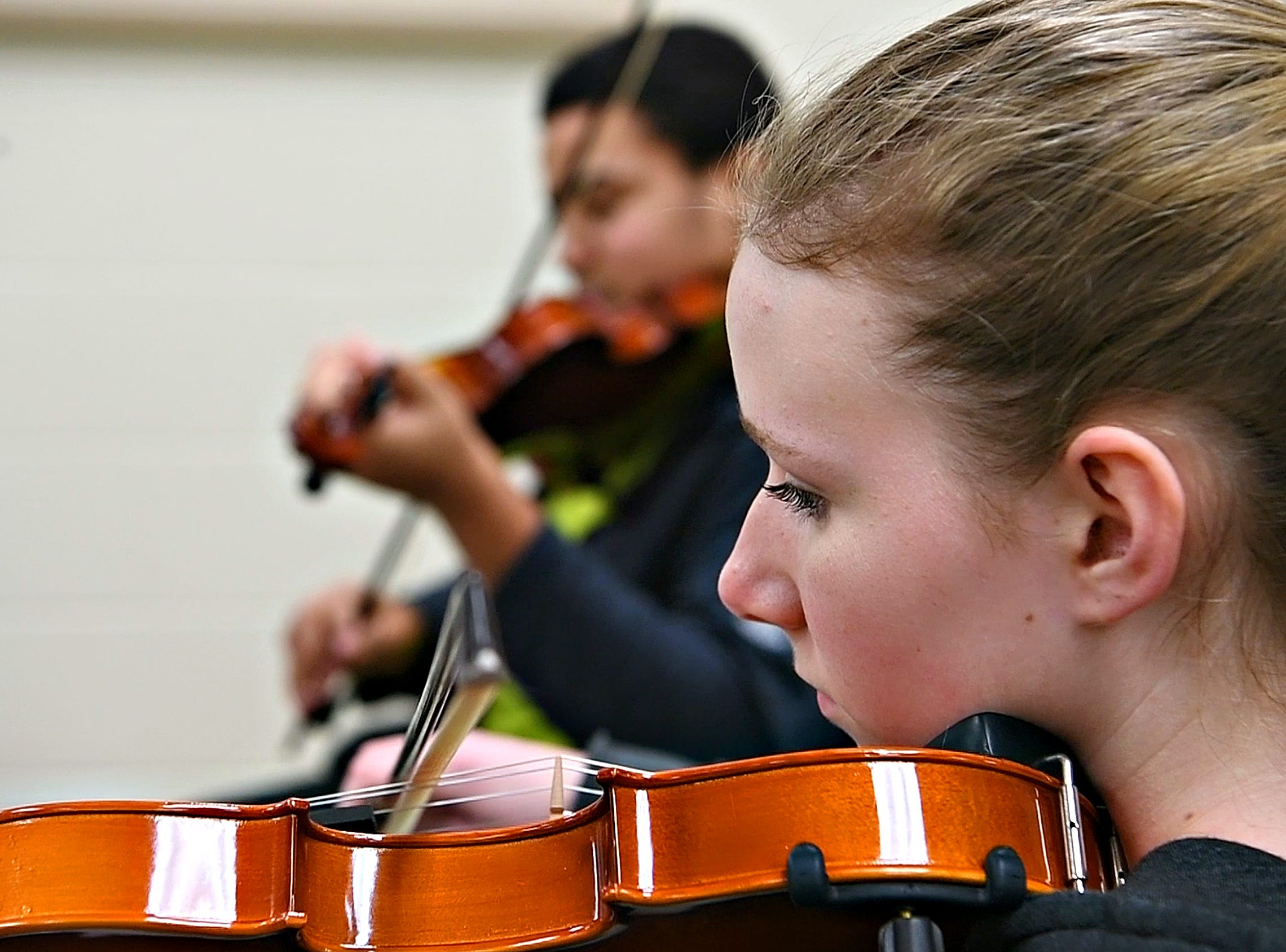 Olivia Mercado plays violin while her ensemble works with Red Lion alumnus Derek Cooper, a working composer in New York, gestures while working with a student ensemble at Red Lion Area High School in Red Lion, Tuesday, March 5, 2019. Dawn J. Sagert photo