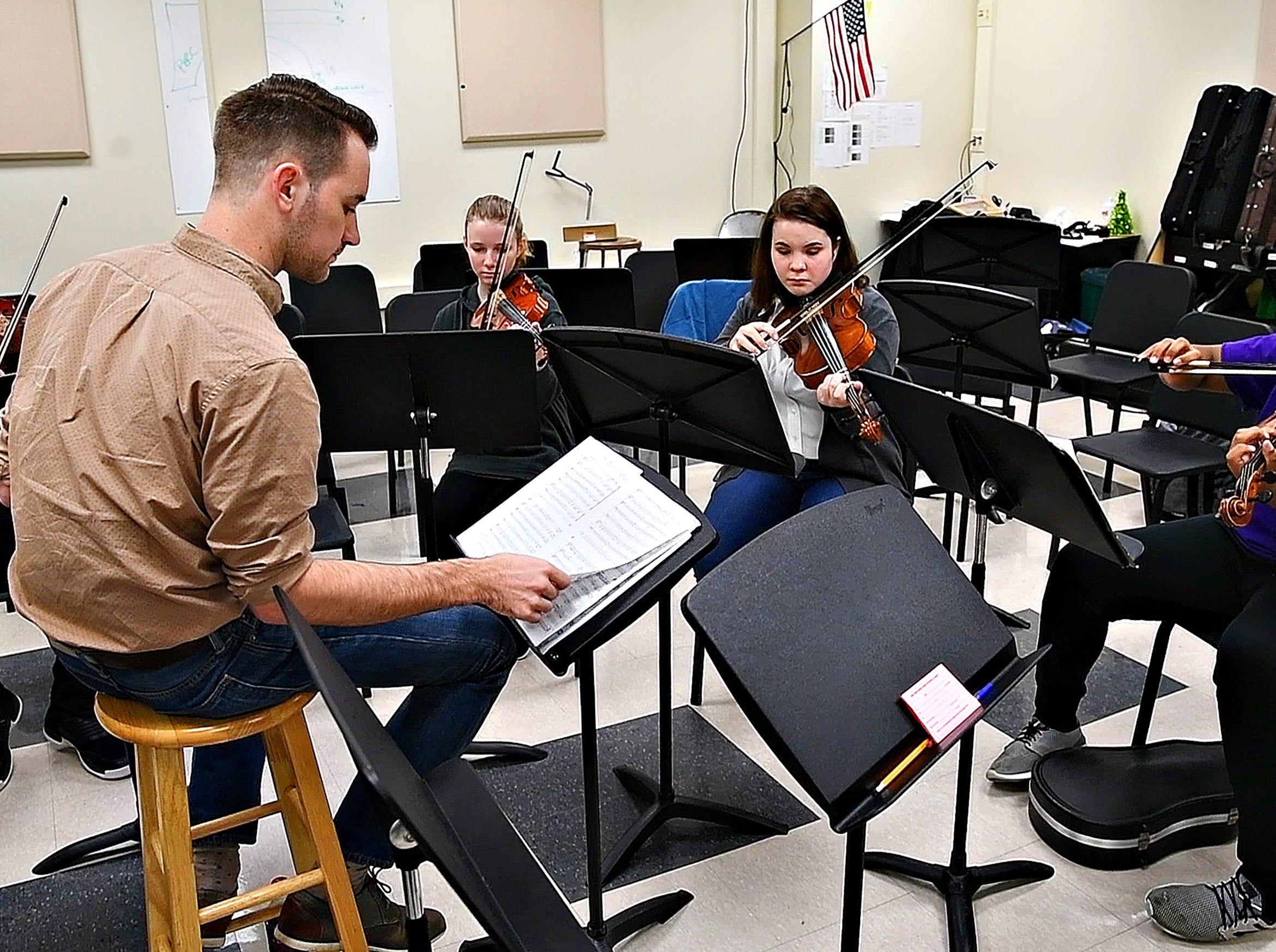 Red Lion alumnus Derek Cooper, a working composer in New York, gestures while working with a student ensemble at Red Lion Area High School in Red Lion, Tuesday, March 5, 2019. Dawn J. Sagert photo