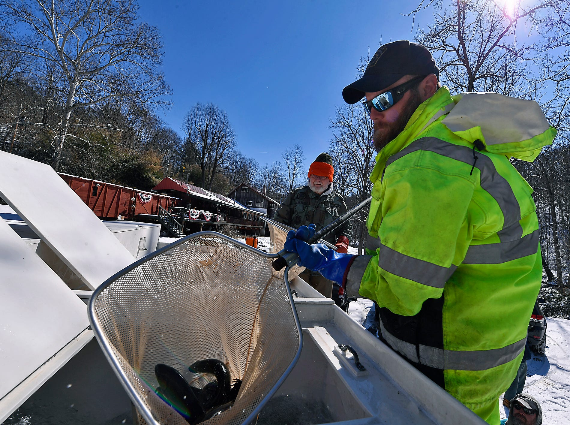 D.J. Beckey, a fish culturist with the PA Fish and Boat Commission scoops up nets full of brown and rainbow trout to be stocked by volunteers from local sportsman's groups in Muddy Creek in southeastern York County, Tuesday, March 5, 2019. The stocking was the first of several that will happen before trout season opens on March 30.John A. Pavoncello photo