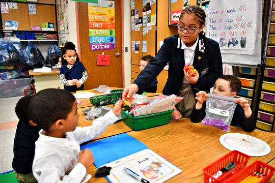 Fifth-grade student ambassador ShaTayla Bailey, 10, hands out bracelets to kindergarten students in celebration of National School Breakfast Week at Lincoln Charter School in York City, Tuesday, March 5, 2019. Dawn J. Sagert photo