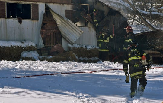 Firefighters work to douse a blaze in a mobile home in the 700 block of Taylor Road in Lower Windsor Township, Tuesday, March 5, 2019. Two people were displaced by the blaze.