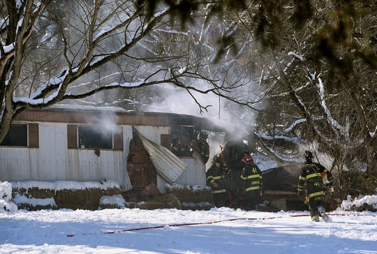 Firefighters work to douse a blaze in a mobile home in the 700 block of Taylor Road in Lower Windsor Township, Tuesday, March 5, 2019. Two people were displaced by the blaze.John A. Pavoncello photo