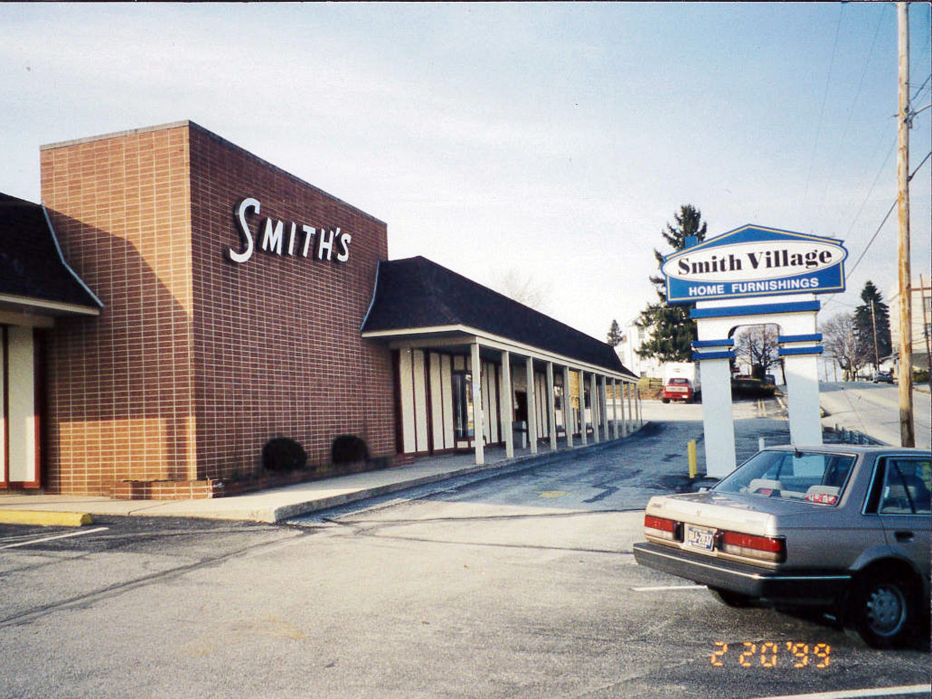 This is Smith Village in Jacobus as it looked in 1999 before the current makeover. The main store received a complete renovation in 1984. At the same time, the hardware department was eliminated, and replaced with a new furniture Clearance Center & Outlet. (This store is now located across the street in the former auto sales building and  known as the Furniture Outlet.)
