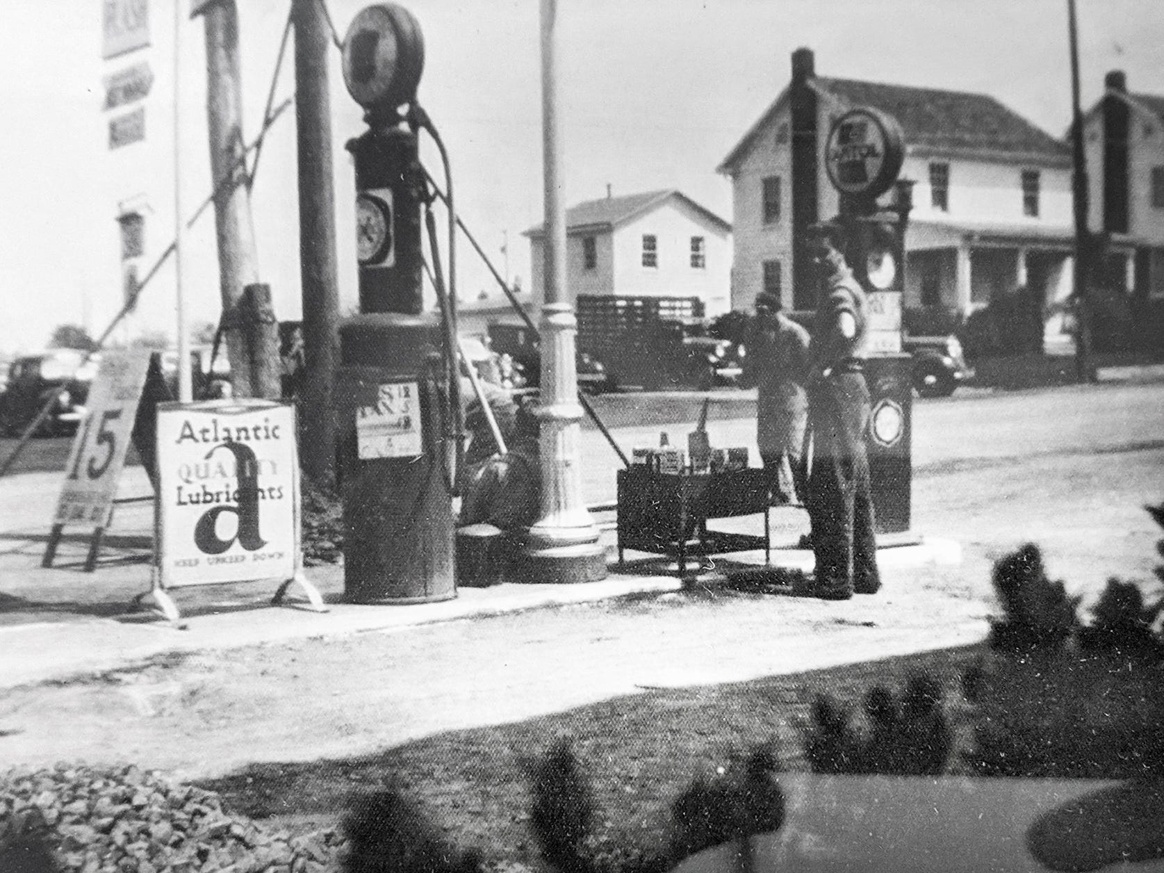 This is a view of gas pumps in front of Smith's store looking across the Susquehanna Trail in Jacobus as they looked in 1937 in the area of the current Smith Village parking lot.