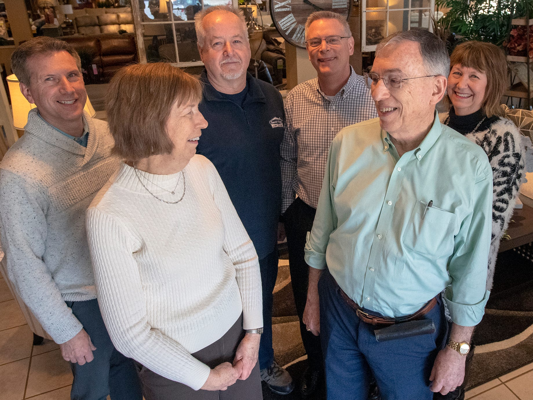 In the front row, current owners Susan Hake (Smith) and Dallas Smith stand with current managers, second row from the left, Bill Ream, Gary Inners, Mark Warner and Colleen Schaffner, who will take over Smith Village.