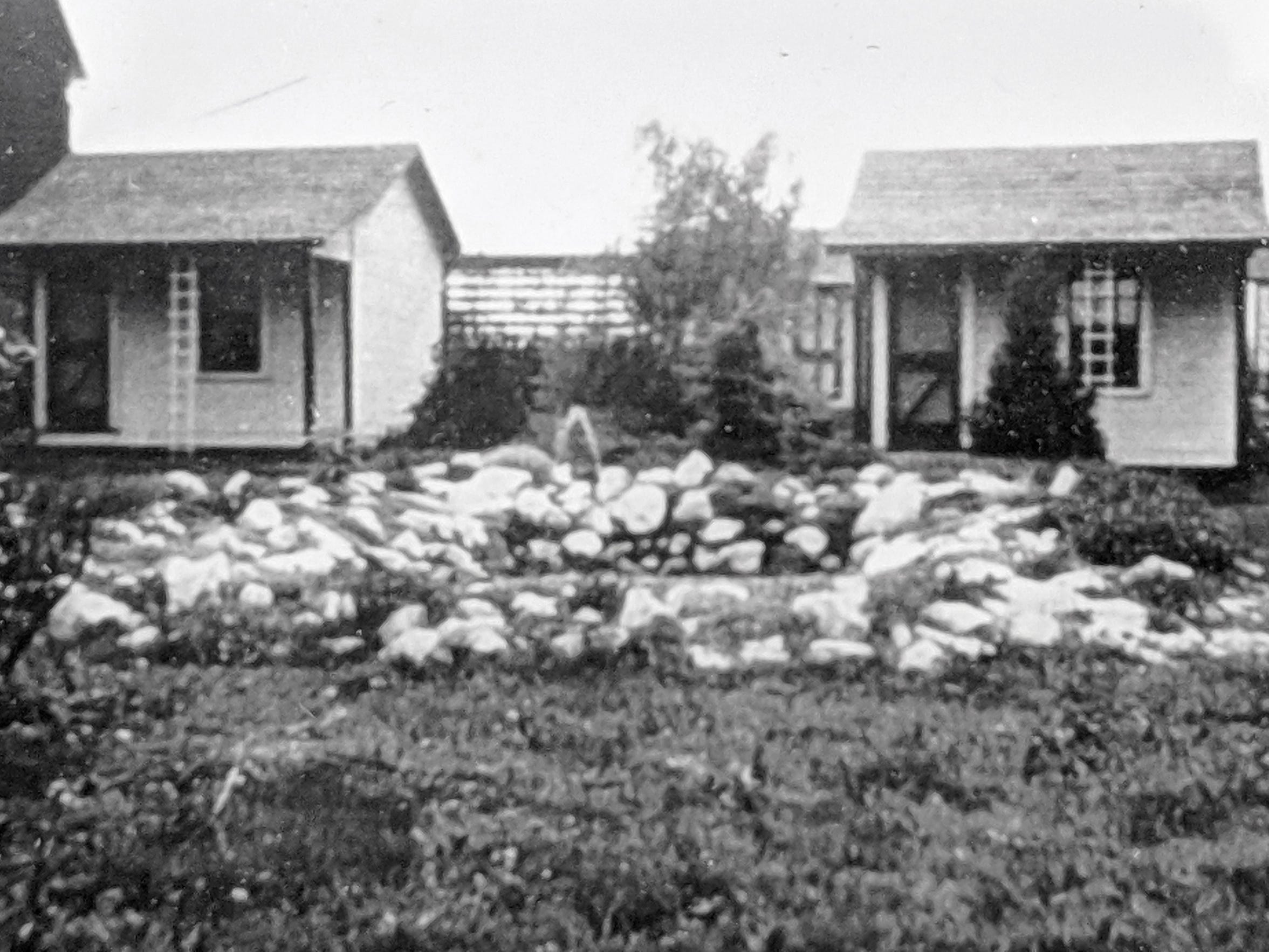 These are Smith's cottages, available as overnight accommodations, as they looked in 1939 behind the current Smith Village building in Jacobus. A pond is in the foreground.