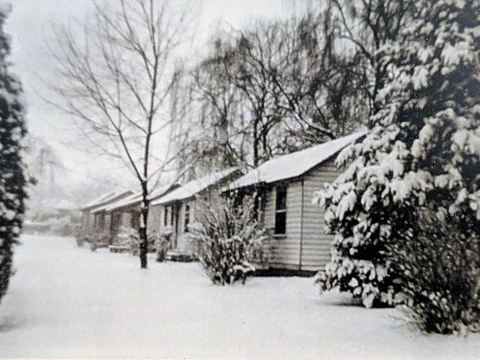 The Smith cottages, which were behind the store, are shown as they looked in 1948.