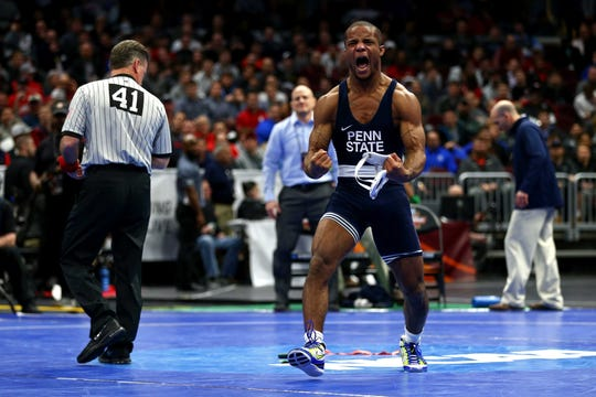 Penn State Nittany Lions wrestler Mark Hall reacts to defeating Mizzou Tigers wrestler Daniel Lewis during the NCAA Wrestling DI Wrestling Championships in 2018.