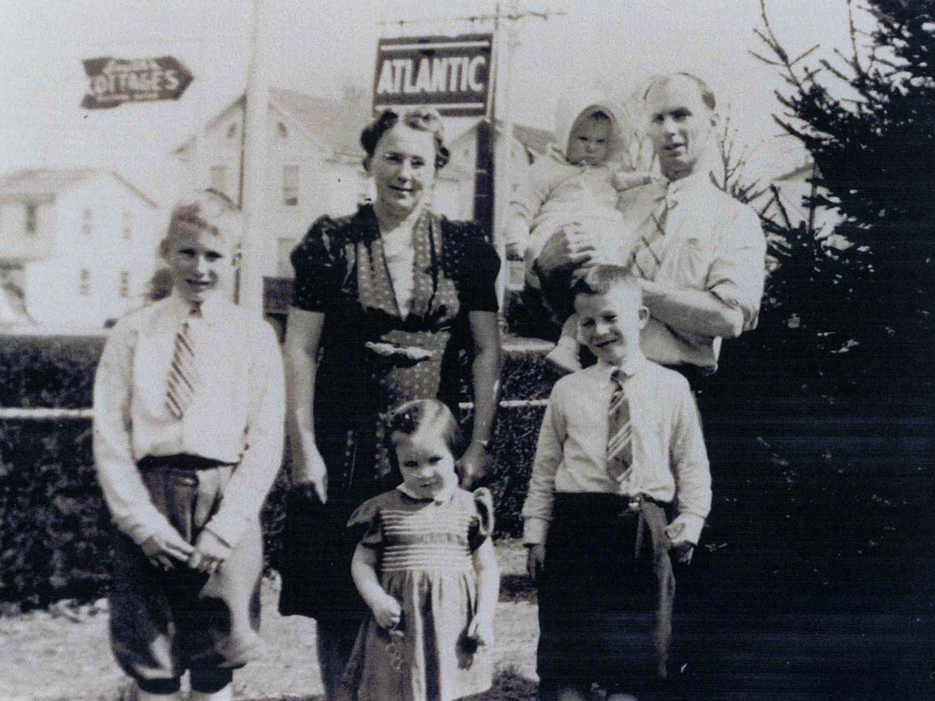 The Smith family stands in front of the Jacobus service station in 1943.