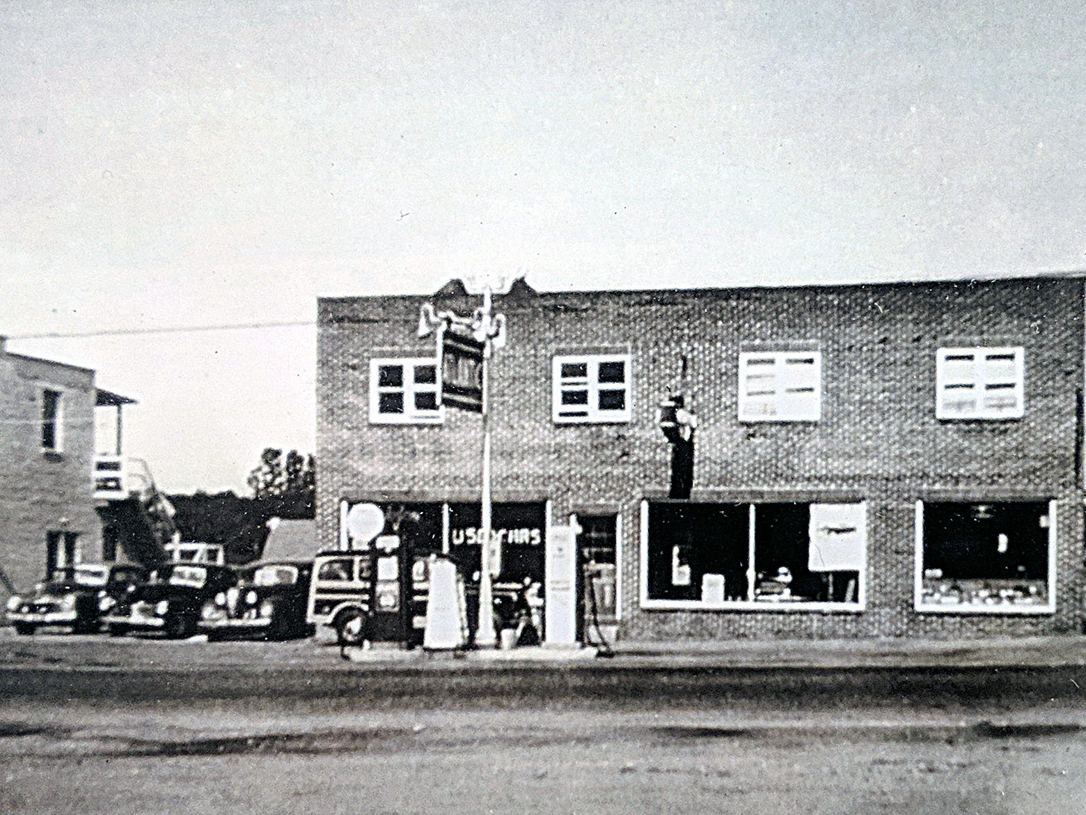This is the Smith car dealership as it looked in 1950. It sold Willys, Hudsons and later American Motors.
