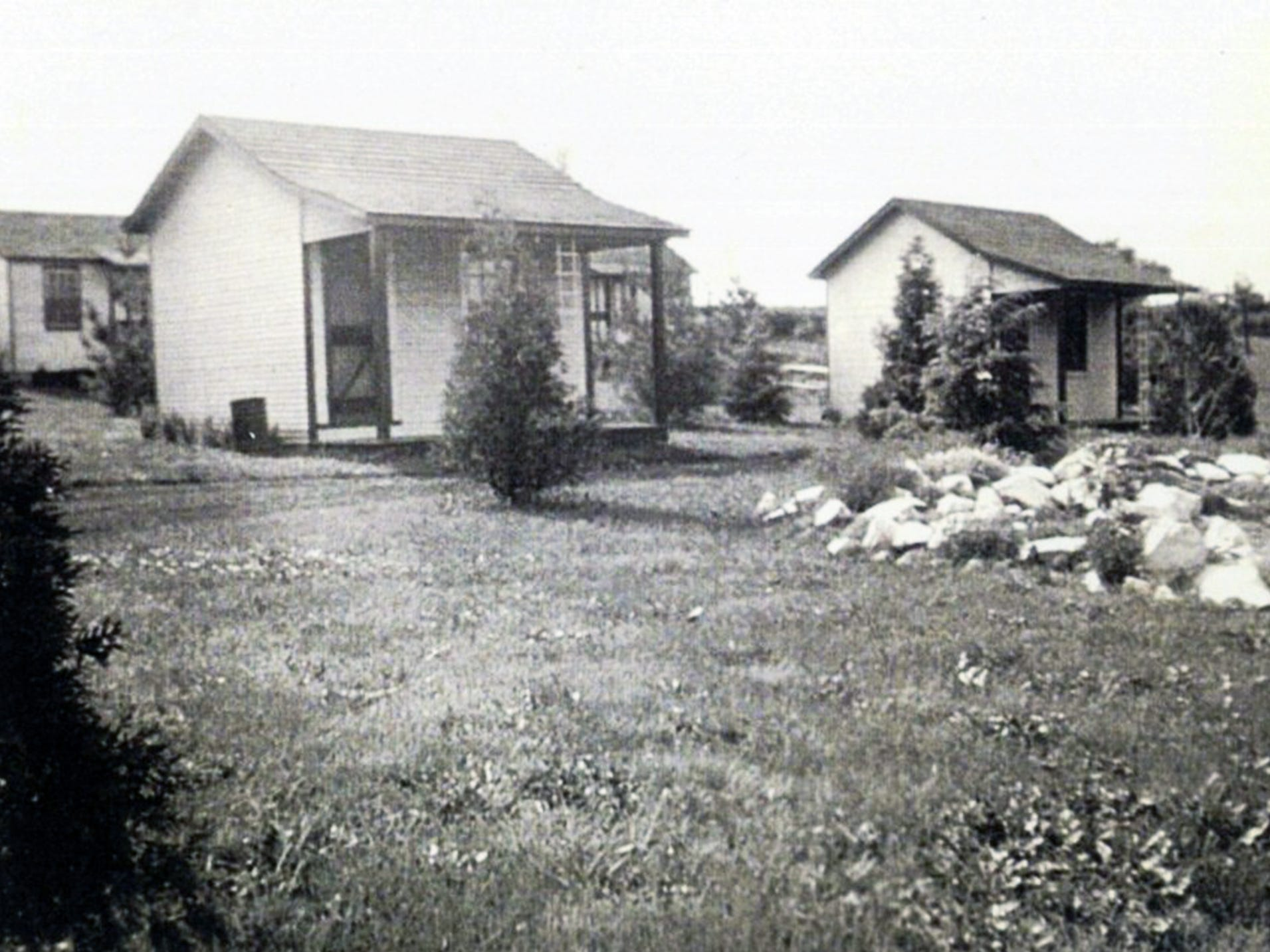 These are Smith's cottages as they looked in this undated photo.