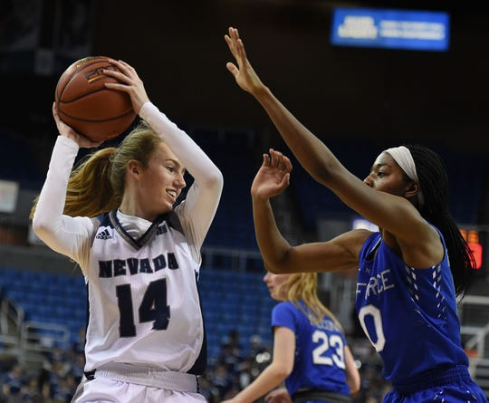 Nevada's Delaney Gosse protects the ball against Air Force's Venessannah Itugbu in Monday's game at Lawlor Events Center.