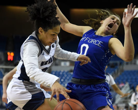 Nevada's Jade Redmon drives against Air Force's Haley Jones during Monday's game at Lawlor Events Center on March 4, 2019.