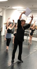 Barbara Land (center) during a rehearsal.