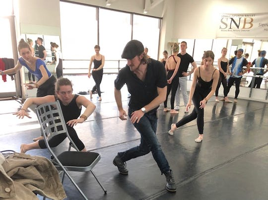 Oliver Adams (center) during a rehearsal.