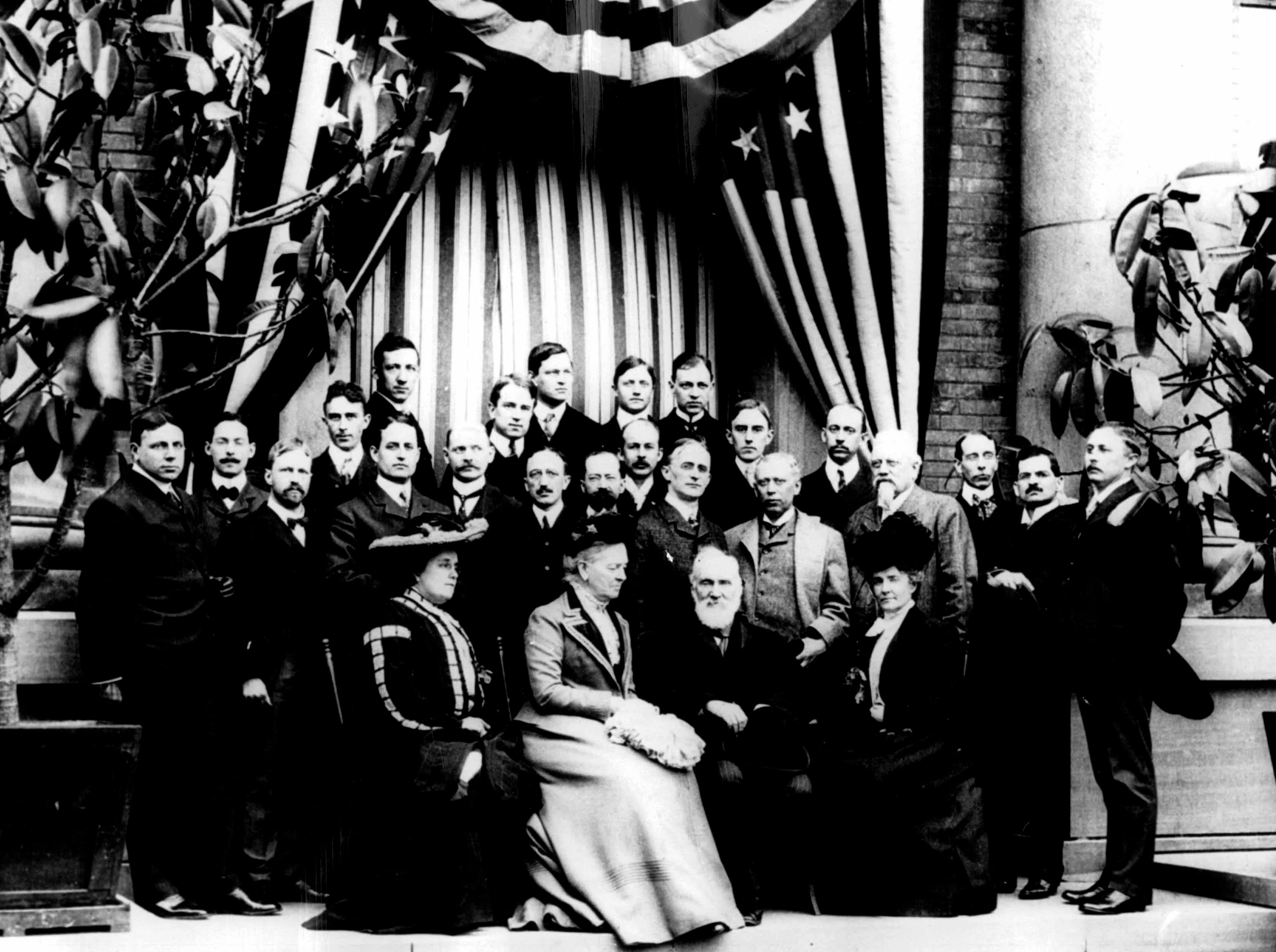 This photo was taken at Kodak Park on April 20, 1902, when the British scientist William Thomson, Baron Kelvin, visited Rochester. Seated are Mrs. George Strong Carter of Honolulu (Helen), Lady Kelvin, Lord Kelvin and Mrs. Charles S. Abbott. Henry A. Strong, the first president of the Eastman Kodak Co. and Mrs. Carter's father, is behind Mrs. Abbott, and Kodak founder George Eastman is behind Lord Kelvin.