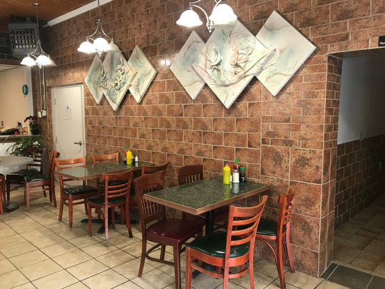Tony's Diner and Vietnamese Restaurant has tables for seating.