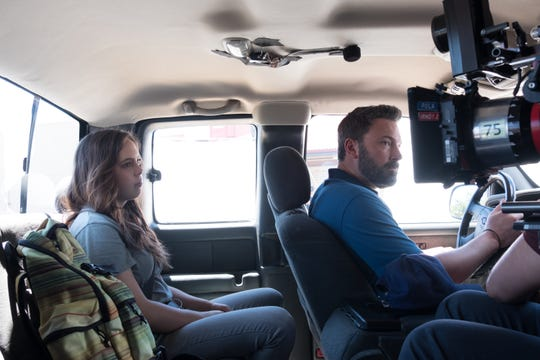 """University of Rochester student Maddy Wary and Ben Affleck film a scene for """"Triple Frontier,"""" a Netflix movie premiering March 13."""