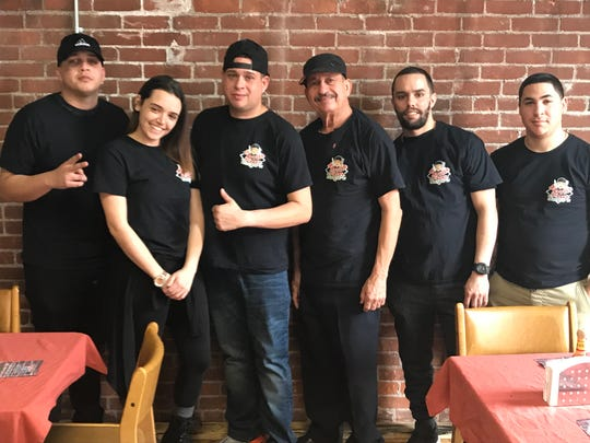 The crew at Burrito Urbano: Cesar Ortiz, Felicia Acevedo, Jorge Velazquez (owner), Jose Velazquez (the owner's father), Joseph Acevedo and Ernesto Llull.