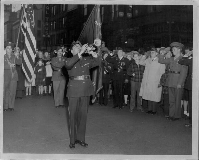 Anthony Infantolino blows taps at the Four Corners on Memorial Day 1944.