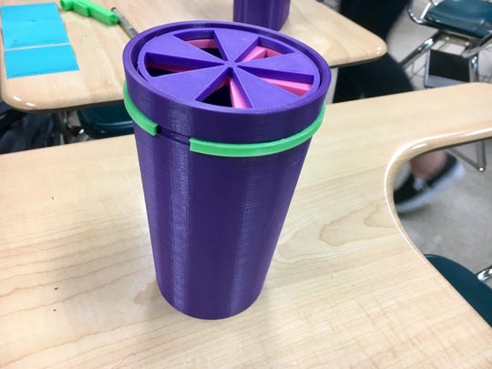 A team of McKay High School students is designing an adaptive cup to help adults with dysphagia as part of the Lemelson-MIT InvenTeams Grant for Invention Projects. This prototype was photographed Feb. 28, 2019.