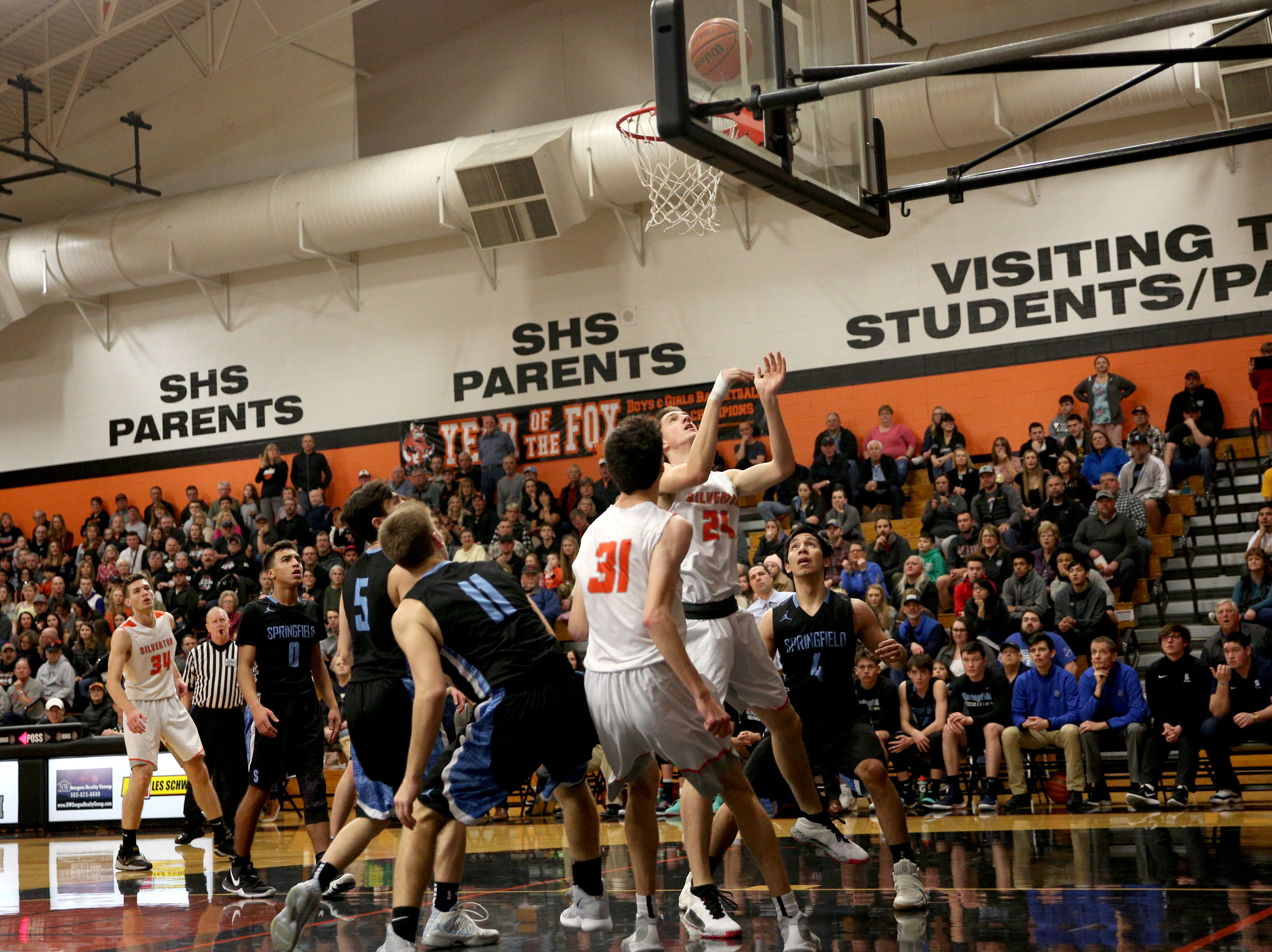 Owen Cote goes up for a shot during the Silverton vs. Springfield boys basketball OSAA state playoffs game at Silverton High School in Silverton on Saturday, March 2, 2019.