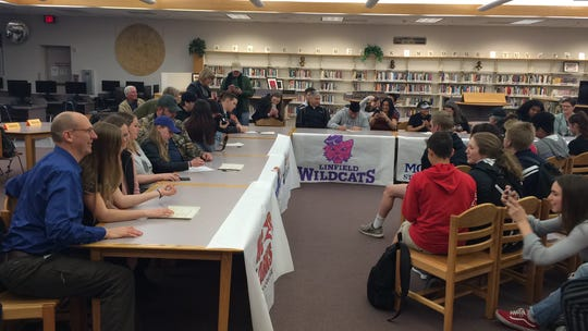 North Salem athletes sign to compete in college Tuesday at the school library.