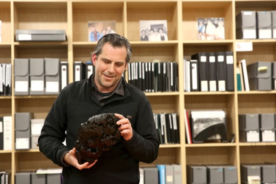 The Confederate Tribes of Grand Ronde Interpretive Coordinator, Travis Stewart, holds a small model of the meteorite Tomanowos, also known as the Willamette meteorite, at the Chachalu Museum and Cultural Center in Grand Ronde on Thursday, Feb. 28, 2019.