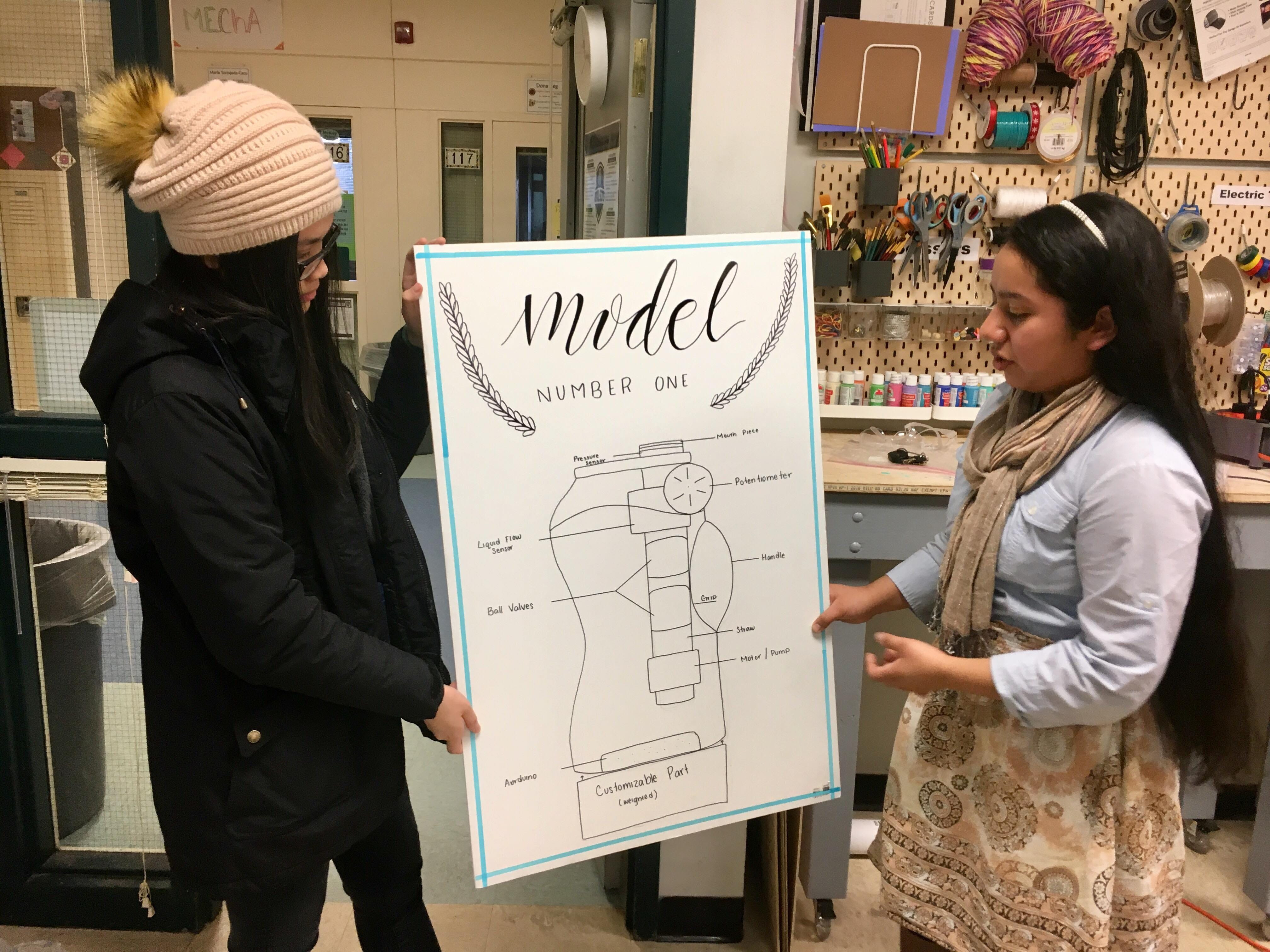 Chau Nguyen, left, and Lesly Rojas work on their presentation Feb. 28. 2019. The two sophomores are part of a team of McKay High School students designing an adaptive cup to help adults with dysphagia as part of the Lemelson-MIT InvenTeams Grant for Invention Projects.