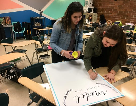 Marisabel Ibarra-Gonzalez, left, and Isabel Mejia work on their presentations on Feb. 28, 2019. The two are part of a team of McKay High School students who are designing an adaptive cup to help adults with dysphagia as part of the Lemelson-MIT InvenTeams Grant for Invention Projects.