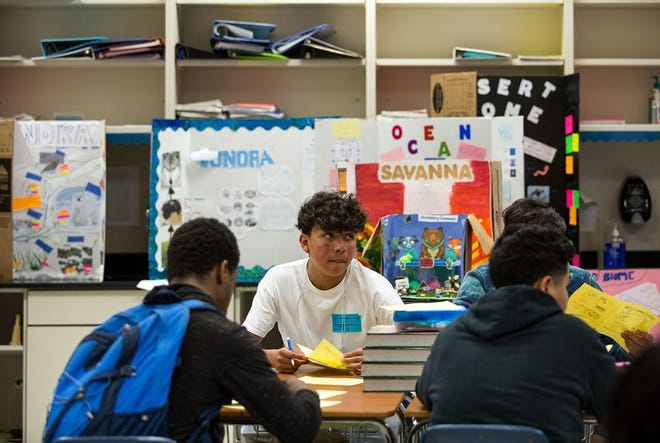 Daniel Saldana, ninth grade student at Elsik High School, looks up during a quiz about biomolecules during an afternoon intervention program on April 19, 2018.