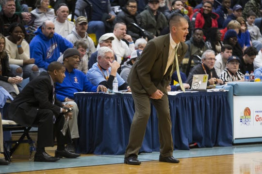 Cape Henlopen head coach Stephen Re rallies his team Thursday night at the DSC Slam Dunk to the Beach at Cape Henlopen High School.