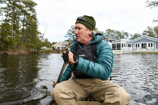 Local resident Bob Collins paddles through the Loop Canal in Bethany Beach on Monday, March 4, 2019. The town is looking at possible solutions to erosion and sediment build up in the canal.