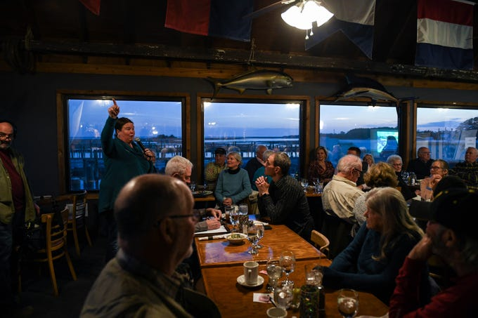 Local residents discuss flooding and sea level rise at a community meeting in Wachapreague, Virginia led by the Nature Conservancy on Monday, March 4, 2019.
