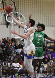 Wi-Hi's Matt Lowe with the layup against Parkside on Monday, March 2, 2019 during the MPSSAA Playoffs.