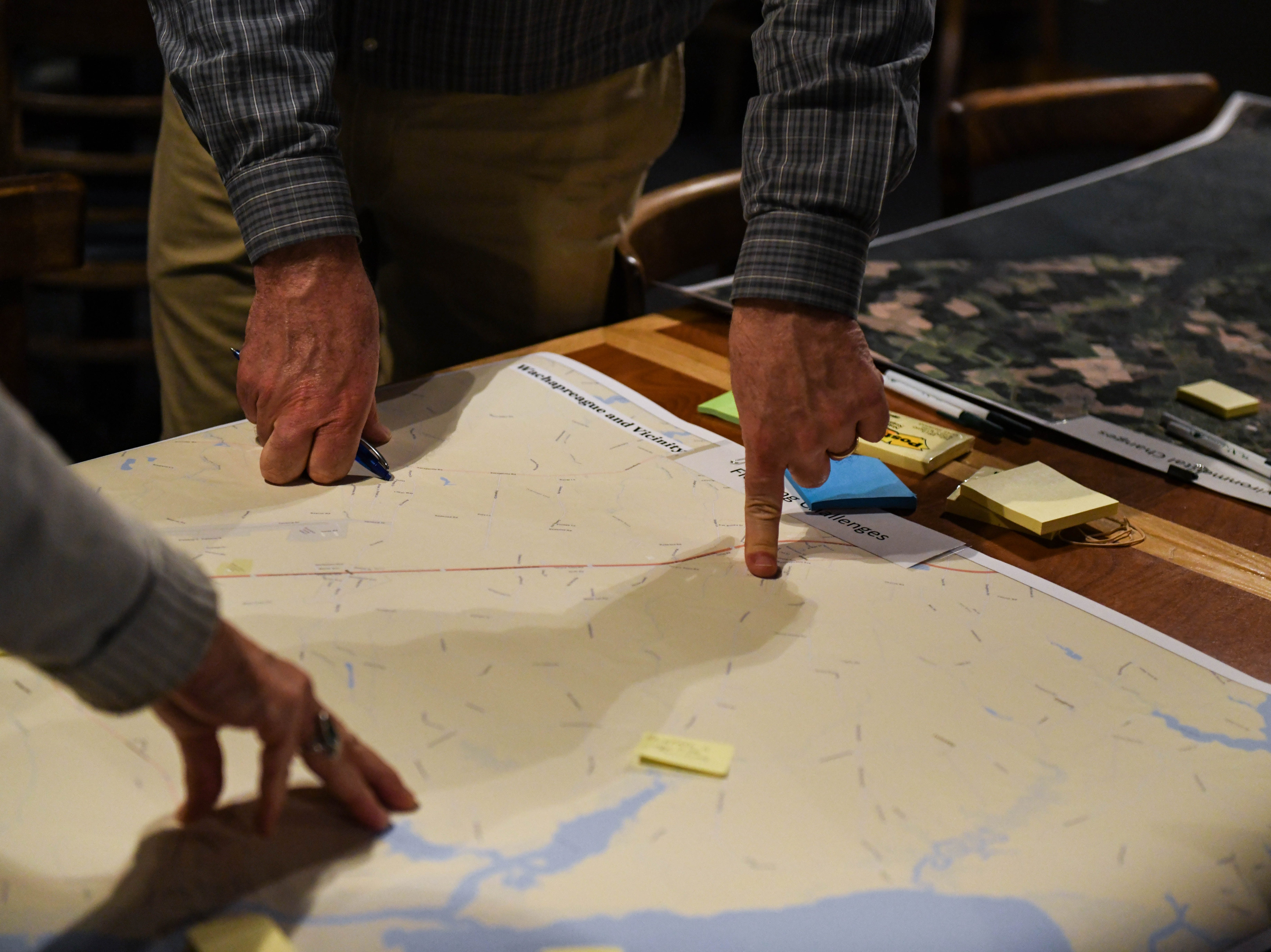 Local residents map local flooding at a community meeting in Wachapreague, Virginia led by the Nature Conservancy on Monday, March 4, 2019.