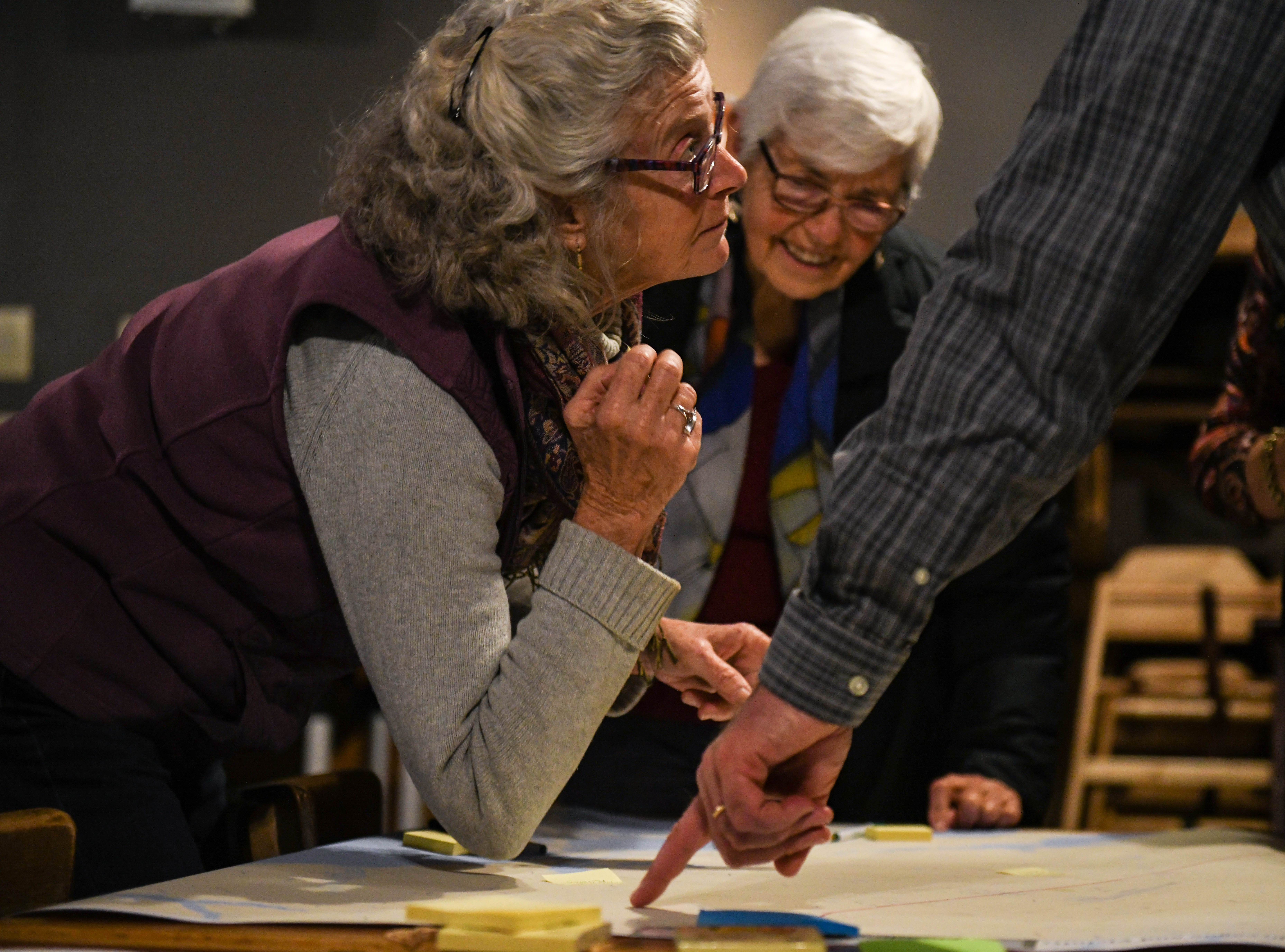 Local resident, Lloyd Johnston, maps local flooding at a community meeting in Wachapreague, Virginia led by the Nature Conservancy on Monday, March 4, 2019.