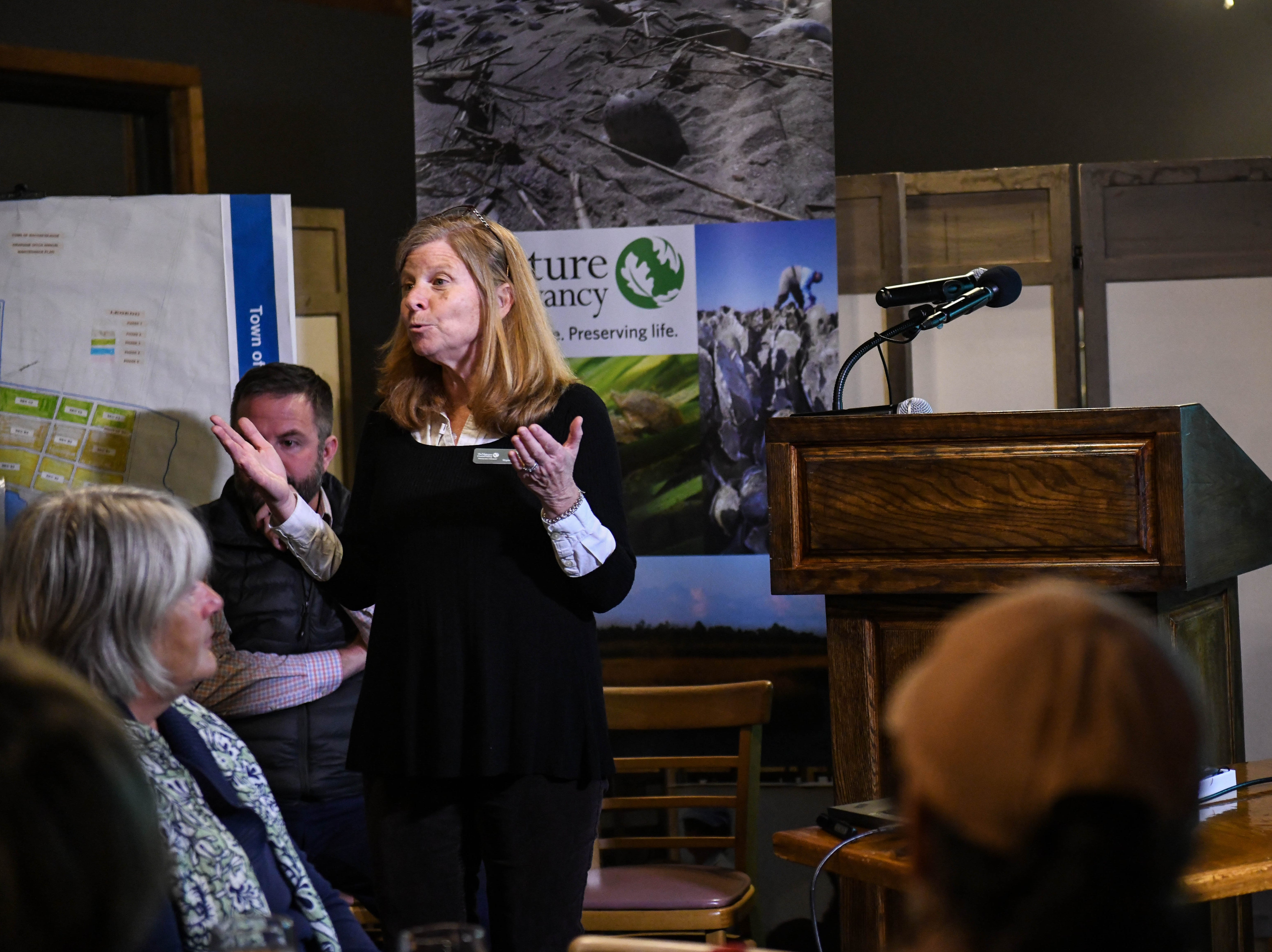 Jill Bieri, director of the Virginia Coast Reserve, presents about flooding and sea level rise at a community meeting in Wachapreague, Virginia led by the Nature Conservancy on Monday, March 4, 2019.