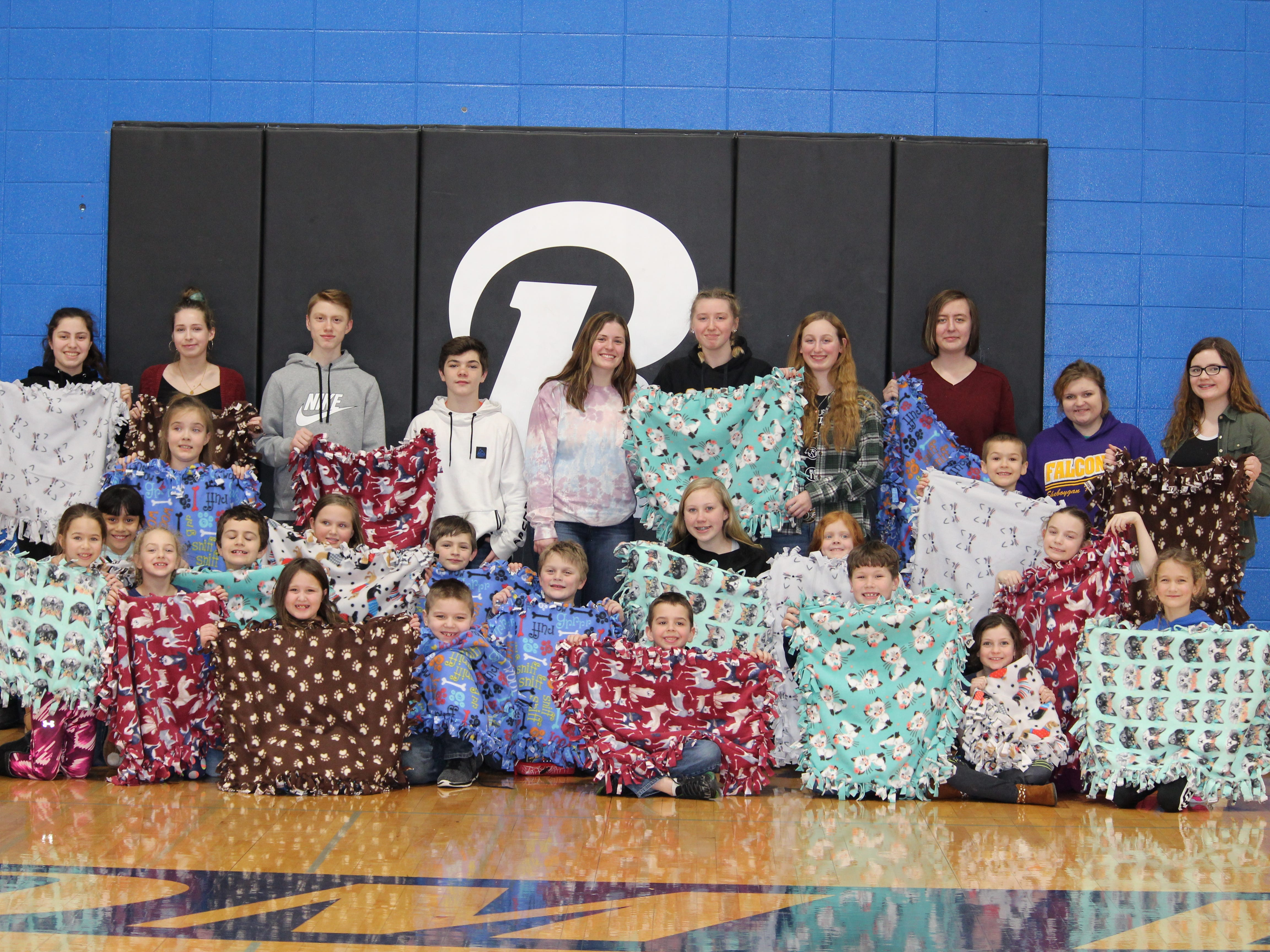 Students participated in a variety of service activities, while also leading elementary students to participate in accomplishing the projects. Some students made blankets for the local animal shelter.