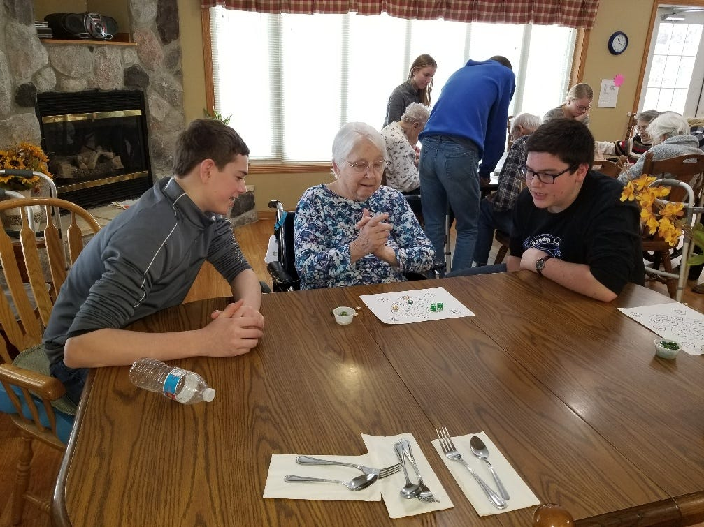 Some students went out into the community and spent time playing games with nursing home residents at Gables on the Pond.